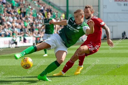 Ryan Porteous (#36) of Hibernian FC clears the ball from Stevie May (#17) of Aberdeen FC during the Ladbrokes Scottish Premiership match between Hibernian and Aberdeen at Easter Road, Edinburgh