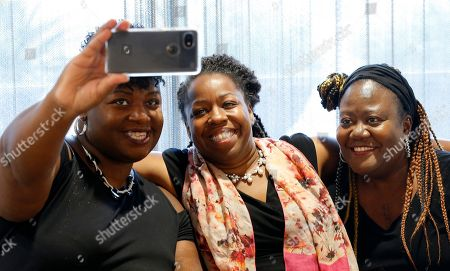 Kiana Maria Sears, middle, a Democrat who is running for the Arizona Corporation Commission, poses for a photo with Aleatheia Mason, left, and Betty Smith, right, during an African-American candidates forum, in Phoenix. She joins at least 30 African-Americans running for local, state and federal office in Arizona this year