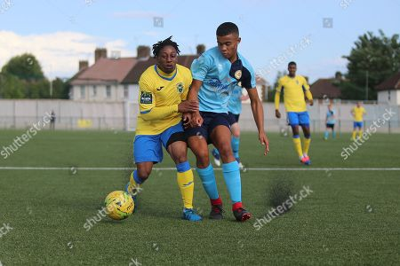 Michael Ademiluyi of Haringey and Jett Hogan of Stanway during Haringey Borough vs Stanway Rovers, Emirates FA Cup Football at Coles Park Stadium on 25th August 2018