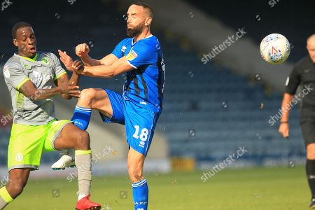 Aaron Wilbraham fouls Isaiah Osbourne during the EFL Sky Bet League 1 match between Rochdale and Walsall at Spotland, Rochdale