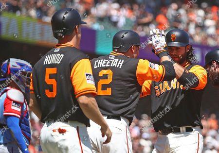 Chase d'Arnaud, Nick Hundley, Brandon Crawford. San Francisco Giants' Brandon Crawford, right, celebrates with Nick Hundley (5) and Chase d'Arnaud (2) after hitting a three-run home run off Texas Rangers pitcher Martin Perez in the first inning of a baseball game, in San Francisco