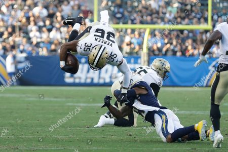 New Orleans Saints running back Shane Vereen (35) leaps over Los Angeles Chargers defensive back Jeff Richards during the first half of an NFL preseason football game, in Carson, Calif