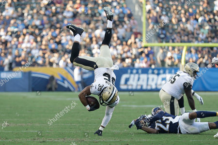 Stock Photo of New Orleans Saints running back Shane Vereen (35) leaps over Los Angeles Chargers defensive back Jeff Richards during the first half of an NFL preseason football game, in Carson, Calif