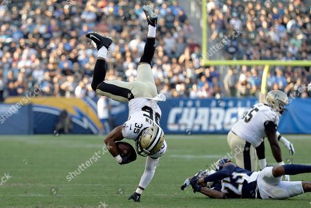 Shane Vereen, Jeff Richards. New Orleans Saints running back Shane Vereen, left, puts a hand to the ground after leaping over Los Angeles Chargers defensive back Jeff Richards, below right, during the first half of an NFL preseason football game, in Carson, Calif