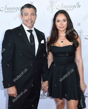 Al Coronel, Christiana Leucas. Al Coronel, left, and Christiana Leucas arrive at the 33rd annual Imagen Awards, at the JW Marriott L.A. Live in Los Angeles