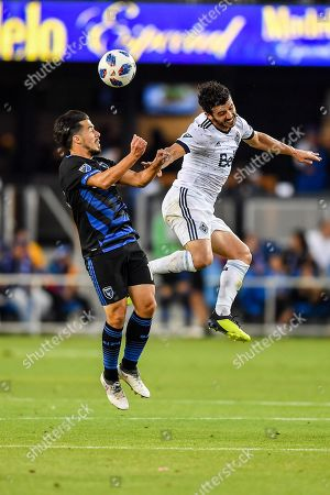 San Jose Earthquakes midfielder Jahmir Hyka (10) and Vancouver Whitecaps midfielder Felipe Martins (8) clash for a header during the MLS match between the Vancouver Whitecaps and the San Jose Earthquakes at Avaya Stadium in San Jose, California