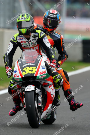 British MotoGP rider Cal Crutchlow of the LCR Honda Castrol Team gives a British MotoGP rider Bradley Smith of the Red Bull KTM Factory Racing Team a lift back to  the pits, during the MotoGP morning warm up of the 2018 Motorcycling Grand Prix of Britain at the Silverstone race track, Northampton, Britain, 26 August 2018.