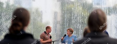 German Chancellor Angela Merkel (2-R) speaks with German athlete Arthur Abele (2-L), decathlon European Champion, during the 20th open day of the German Federal Government in Berlin, Germany, 26 August 2018. During the 20th open day of the Federal Government, visitors may have a look inside the Chancellery and most of the Government's ministries on 25 and 26 August 2018.
