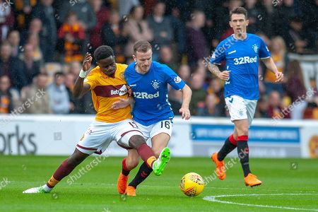 Gael Bigirimana (#17) of Motherwell FC tackles Andy Halliday (#16) of Rangers FC during the Ladbrokes Scottish Premiership match between Motherwell and Rangers at Fir Park, Motherwell