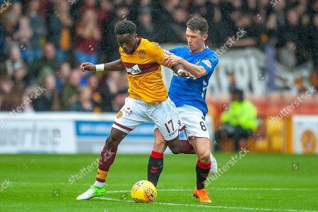 Gael Bigirimana (#17) of Motherwell FC holds off Ryan Jack (#8) of Rangers FC during the Ladbrokes Scottish Premiership match between Motherwell and Rangers at Fir Park, Motherwell