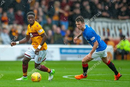 Gael Bigirimana (#17) of Motherwell FC and Ryan Jack (#8) of Rangers FC during the Ladbrokes Scottish Premiership match between Motherwell and Rangers at Fir Park, Motherwell