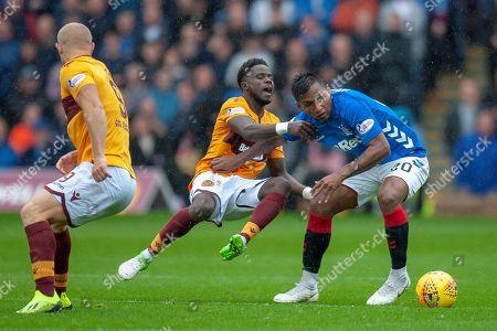 Alfredo Morelos (#20) of Rangers FC fouls Gael Bigirimana (#17) of Motherwell FC during the Ladbrokes Scottish Premiership match between Motherwell and Rangers at Fir Park, Motherwell
