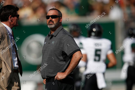 R m. Hawaii Warriors head coach Nick Rolovich warms up before the first half of an NCAA college football game, in Fort Collins, Colo