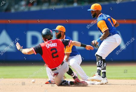 Washington Nationals' Adam Eaton (2) steals second base as New York Mets shortstop Amed Rosario waits for the throw and Jose Reyes (7) backs up during the eighth inning of a baseball game, in New York