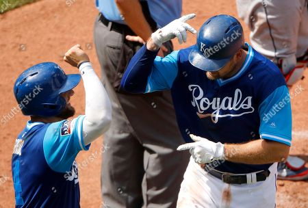 Kansas City Royals' Lucas Duda, right, celebrates with Alex Gordon after hitting a two-run home run during the sixth inning of a baseball game against the Cleveland Indians, in Kansas City, Mo
