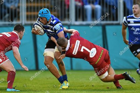 Zach Mercer of Bath Rugby fends James Davies of the Scarlets