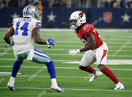 Dallas Cowboys wide receiver Lance Lenoir (14) looks for room against Arizona Cardinals cornerback Deatrick Nichols (39) during the second half of a preseason NFL football game in Arlington, Texas