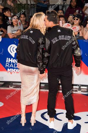 Alex Karolczyk, Tyler Shaw. Tyler Shaw, right, and Alex Karolczyk kiss at the iHeartRadio MuchMusic Video Awards, in Toronto