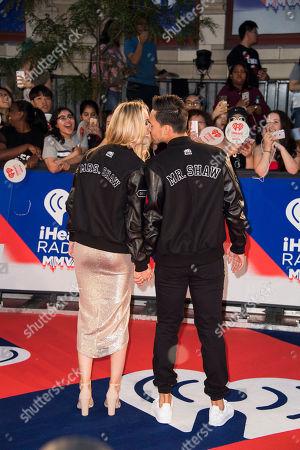 Tyler Shaw, Alex Karolczyk. Tyler Shaw, right, and Alex Karolczyk kiss at the 2018 iHeartRadio MuchMusic Video Awards, in Toronto