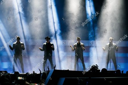 Stock Photo of From left, Nick Lachey, Justin Jeffre, Jeff Timmons and Drew Lachey of 98 Degrees perform at the 2018 iHeartRadio MuchMusic Video Awards, in Toronto