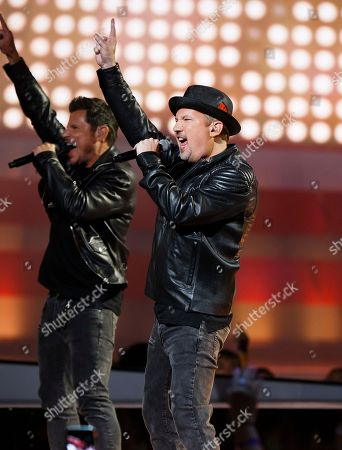 From left, Nick Lachey and Justin Jeffre of 98 Degrees perform at the 2018 iHeartRadio MuchMusic Video Awards, in Toronto