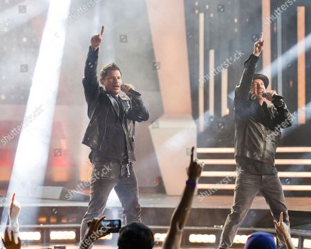 Stock Image of From left, Nick Lachey and Justin Jeffre of 98 Degrees perform at the 2018 iHeartRadio MuchMusic Video Awards, in Toronto