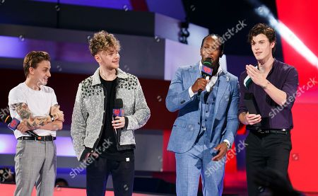 From left, Scott Helman, Francesco Yates, Tyrone Edwards and Shawn Mendes speak at the 2018 iHeartRadio MuchMusic Video Awards, in Toronto