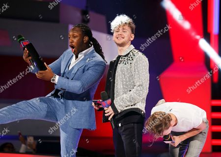 From left, Tyrone Edwards, Francesco Yates and Scott Helman speak at the 2018 iHeartRadio MuchMusic Video Awards, in Toronto