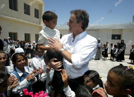 Editorial image of Prime Minister Tony Blair Receives A Peck On The Cheek From 6 Year Old Abbas Adnan At Khadija Alkobra Girls School In The Southern Iraq Town Of Basra During His Visit. See Ross Benson Story.