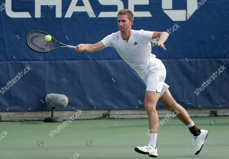 Stock Image of Florian Mayer, of Germany, returns a shot to Borna Coric, of Croatia, during the first round of the U.S. Open tennis tournament, in New York