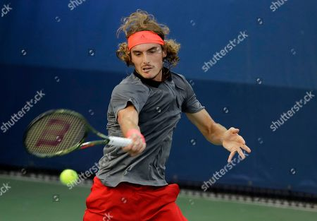 Stefanos Tsitsipas, of Greece, returns a shot to Tommy Robredo, of Spain, during the first round of the U.S. Open tennis tournament, in New York