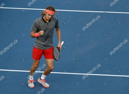 Stefanos Tsitsipas, of Greece, reacts against Tommy Robredo, of Spain, during the first round of the U.S. Open tennis tournament, in New York