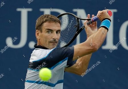 Tommy Robredo, of Spain, returns a shot to Stefanos Tsitsipas, of Greece, during the first round of the U.S. Open tennis tournament, in New York