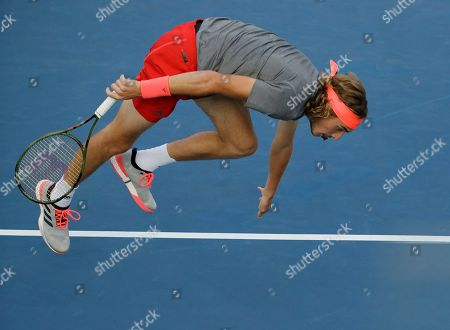 Stefanos Tsitsipas, of Greece, falls during his match against Tommy Robredo, of Spain, during the first round of the U.S. Open tennis tournament, in New York