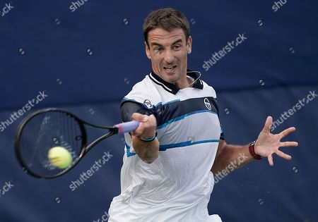 Tommy Robredo of Spain hits a return to Stefanos Tsitsipas of Greece during the first day of the US Open Tennis Championships the USTA National Tennis Center in Flushing Meadows, New York, USA, 27 August 2018. The US Open runs from 27 August through 09 September.