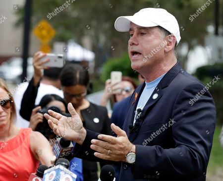 Florida Democratic gubernatorial candidate Philip Levine talks to members of the media, near the scene of a mass shooting at The Jacksonville Landing in Jacksonville, Fla. A gunman opened fire Sunday at a video game tournament killing multiple people and then fatally shooting himself in a rampage that wounded several others