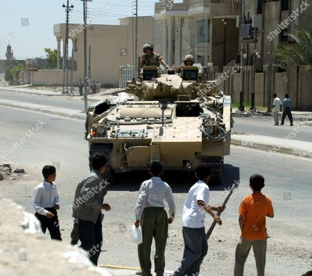 Stock Photo of British Blackwatch Soldiers In Their Warrior Armoured Vehicle Patrol The Streets Outside Khadija Alkobra Girls School In The Southern Iraq Town Of Basra Which Was Visited By British Prime Minister Tony Blair. See Ross Benson Story.