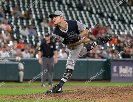 New York Yankees relief pitcher David Robertson (30) works in the ninth inning against the Baltimore Orioles. The Yankees won the game 5 - 3.