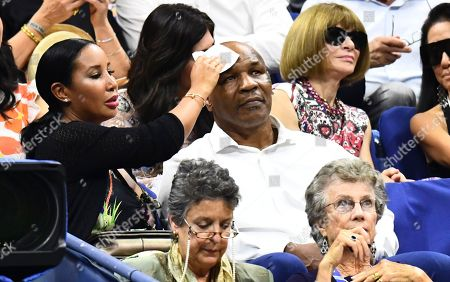 Mike Tyson has his head wiped by his wife Kiki on a hot and sultry night in New York