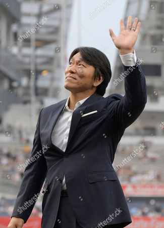 Former New York Yankees player Hideki Matsui is honored with a ceremony celebrating his induction into the Japanese Baseball Hall of Fame, earlier in the year, before a baseball game between the Yankees and the Chicago White Sox, at Yankee Stadium in New York