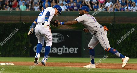 Chicago Cubs' Javier Baez (9) is picked off by New York Mets shortstop Jose Reyes, right, while trying to steal second base during the first inning of a baseball game on Monday, Aug, 27, 2018, in Chicago
