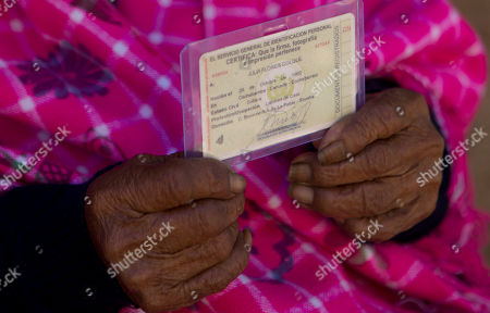 117-year-old Julia Flores Colque holds her identification card displaying her date of birth in Sacaba, Bolivia. Birth certificates did not exist in Bolivia until 1940, and births previously were registered with baptism certificates provided by Roman Catholic priests. Flores Colque's national identity card has been certified by the Bolivian government