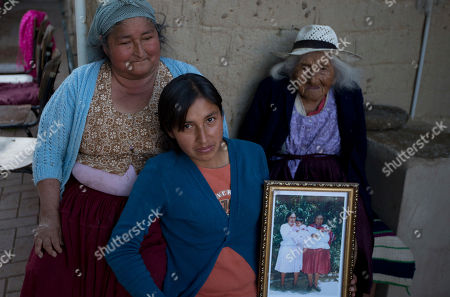 117-year-old Julia Flores Colque Julia Flores Colque, behind right, poses for a photo with her grandniece Agustina Berna, left, and her great-grandniece Rosa Lucas at their home in Sacaba, Bolivia. In her long life, Julia has witnessed two world wars, revolutions in her native Bolivia and the transformation of her rural town of Sacaba from 3,000 people to a bustling city of more than 175,000 people in just five decades