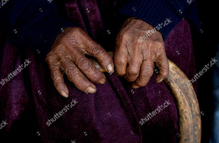 117-year-old Julia Flores Colque holds onto her cane in Sacaba, Bolivia. The previously world's oldest person, a 117-year-old Japanese woman, died earlier this year. Her passing apparently left Flores Colque as the world's oldest living person