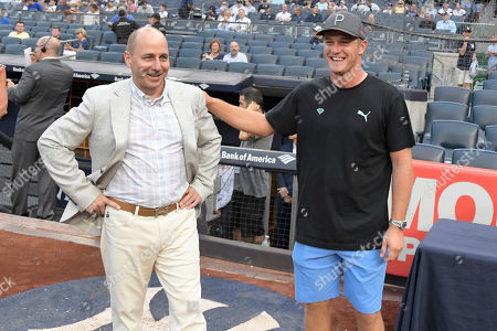 Golfer Bryson DeChambeau, right, poses with New York Yankees general manager Brian Cashman before a baseball game between the New York Yankees and the Chicago White Sox, at Yankee Stadium in New York. DeChambeau won the PGA Tour's The Northern Trust 2018 on Sunday, which is the first of four events in the FedExCup Playoffs