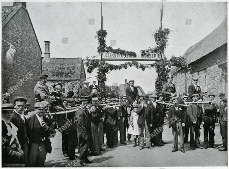 'Chairing and Poleing ' Visitors. the Leaders of the Fair Having Been Duly Imprisoned People Are Seized Indiscriminately and Carried Off in Triumph to the Stocks Some Mounted in Chairs and Others Much More Uncomfortably Astride A Pole Or 'Stang' For not Buying A Ticket! A Ancient Custom Which Has Died out in Its Entirety Last Recorded in 1862 Was A Punishment Designed to Awaken Shame in A Delinquent by Exposing Them in Public Ridicule with 'Rough Music' Being Played by Villages Who Created an Earsplitting Noise Beating Frying Pans and Other Kitchen Utensils. Photograph by Benjamin Stone in 'Sir Benjamin Stone's Pictures', Page 4