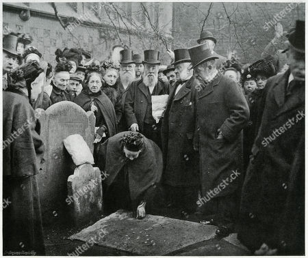Centuries-old Tradition When Twenty-one Sixpences Were Placed Upon A Flat Gravestone in the Churchyard at St. Bartholomew in Smithfield London On Good Friday Morning. Gathered Are Twenty-one Aged Widows with the Church Officials and A Few Spectators. Photograph Showing A Widow Kneeling and Picking Up One of the Sixpences On Rising She Receives A Freshly-baked Hot-cross Bun From Another Gentleman Who Then Assists Her to Walk Over the Stone Subsequently Each Widow is Presented with A Penny and Hot-cross Bun the Gift From the Churchwarden. Photograph by Benjamin Stone in 'Sir Benjamin Stone's Pictures', Page 5