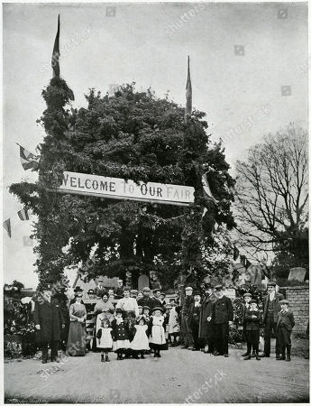 Once Every Twenty Years On Whit-monday the People of Corby in Northamptonshire Celebrate by Holding A Unique Fair in Commemoration of A Charter Granted to Them by Queen Elizabeth in 1585 and Confirmed by Charles Ii in 1682. Decorated with Bunting and Evergreens Arched with the Sign 'Welcome to Our Fair' Visitors Entering Would Have to Pay A Toll Who Ever Passes Without A 'Toll Tickert' (the Value is Optional) Would Be Placed Into the Stocks There Remain Till They Pay. Photograph by Benjamin Stone in 'Sir Benjamin Stone's Pictures', Page 1
