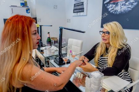 Kristin M. Davis opened ' Michelle 'Bombshell' McGee Beauty Lab', a beauty salon at an East Harlem storefront