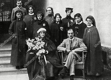 Stock Image of Millicent Duchess of Sutherland Pictured at the Hague with Her Party of Nurses After They Had Returned From the Heavily Bombarded Town of Namur where They Had Set Up A Hospital. They Moved From Namur to Maubeuge and Then Brussels Before the Germans Gave Them A Pass to Travel to Holland. the Duchess is Seated in Front Holding A Bunch of Flowers with Dr. Morgan. . Page From the Sketch, 30 September 1914